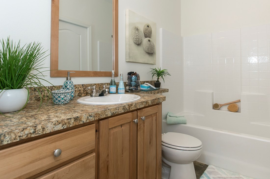 The ING382F REDWOOD II   (FULL) GW Guest Bathroom. This Manufactured Mobile Home features 2 bedrooms and 2 baths.