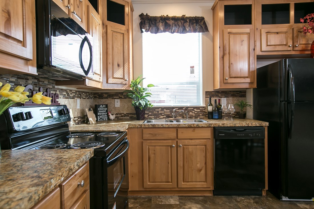 The ING382F REDWOOD II   (FULL) GW Kitchen. This Manufactured Mobile Home features 2 bedrooms and 2 baths.