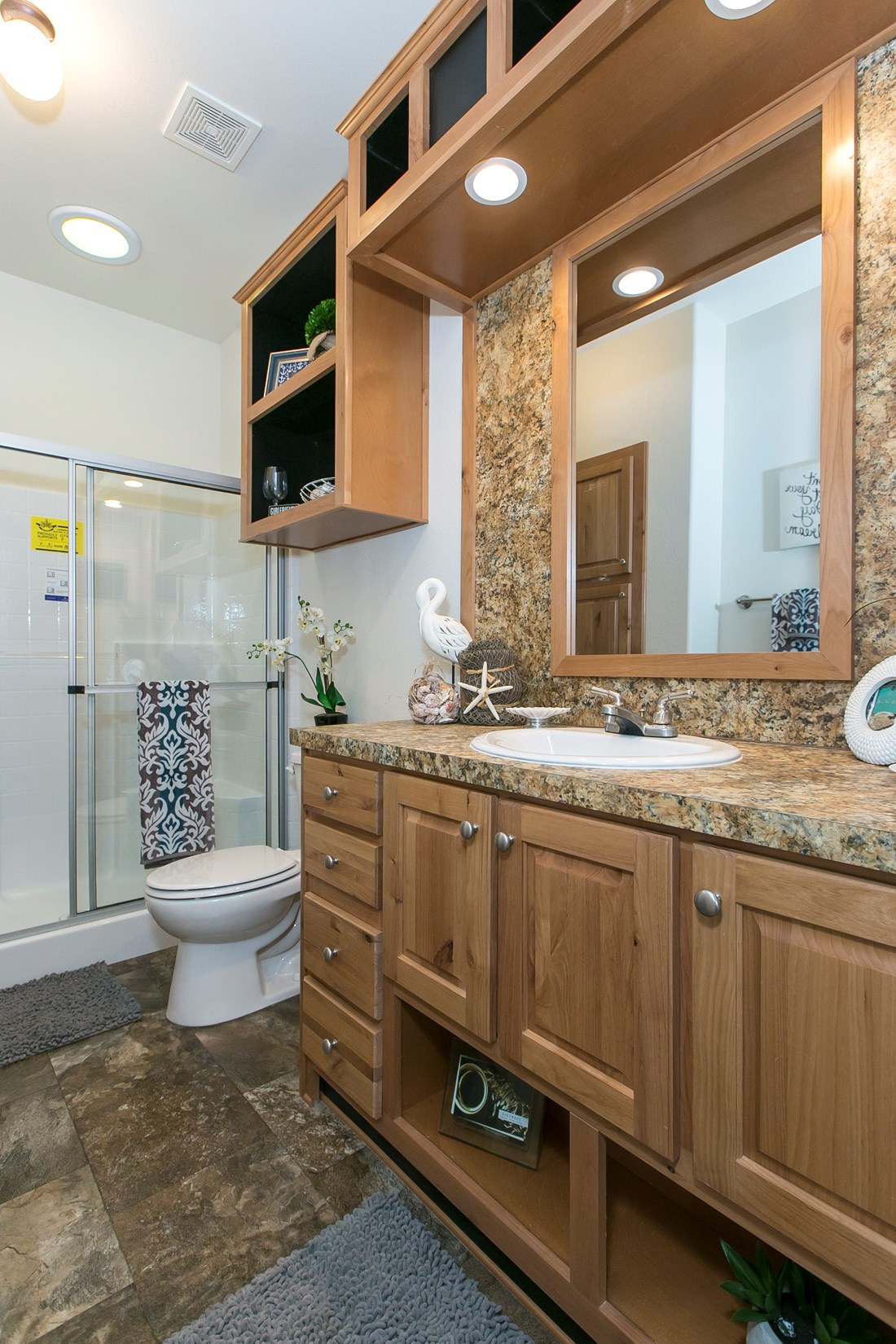 The ING382F REDWOOD II   (FULL) GW Master Bathroom. This Manufactured Mobile Home features 2 bedrooms and 2 baths.